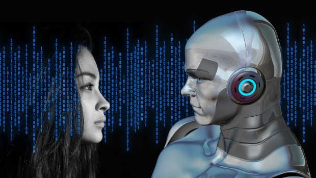 Human and robot facing each other