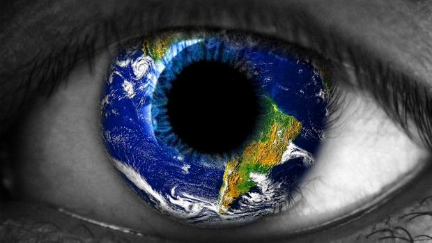 Human eye with earth in the centre.