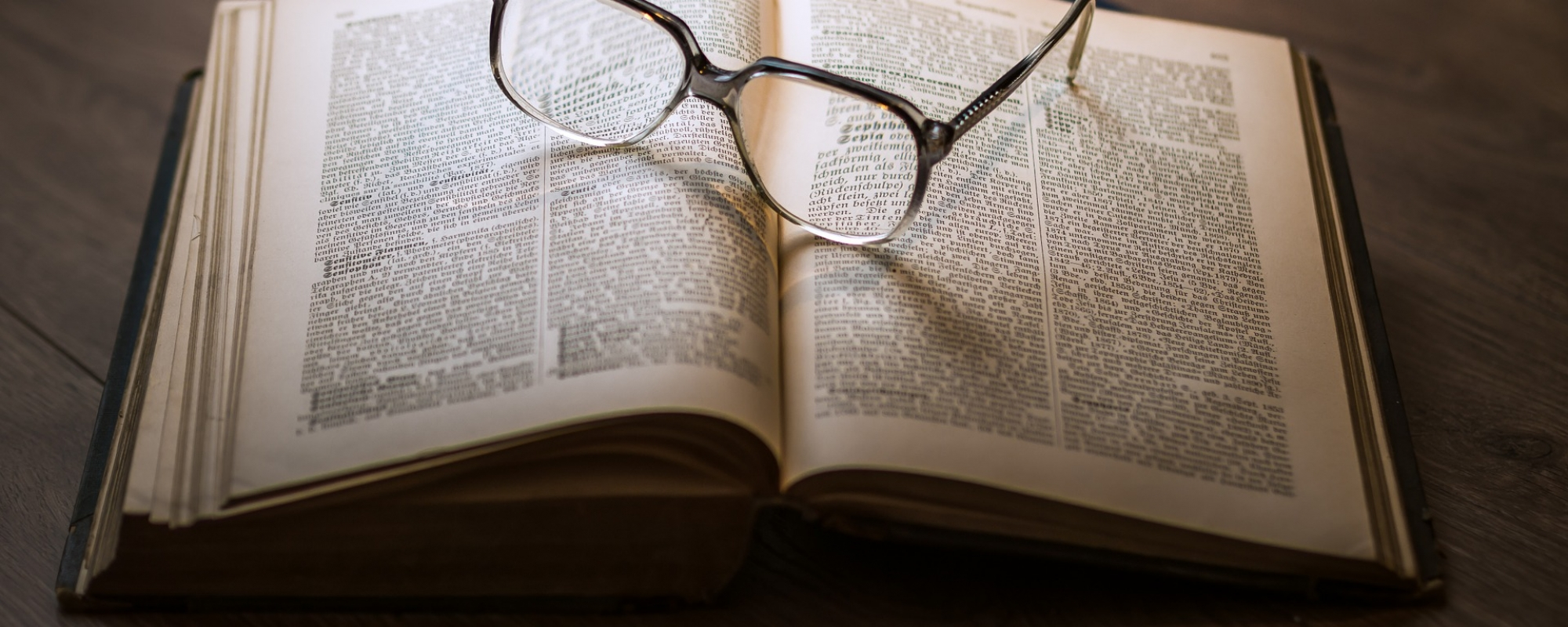 Spectacles on an open book